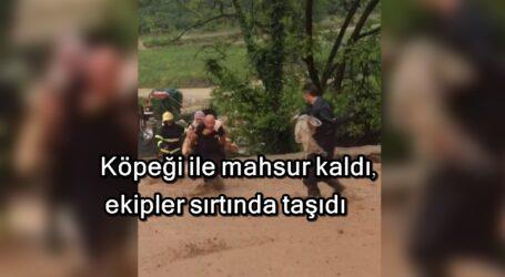Köpeği ile mahsur kaldı, ekipler sırtında taşıdı